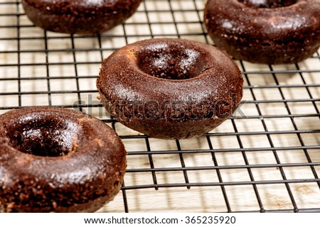 Morning breakfast with donuts. homemade chocolate donuts  on wooden background. Doughnut background
