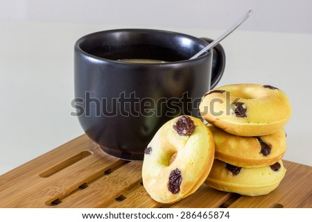 Morning breakfast with donuts, raisin and coffee - stock photo