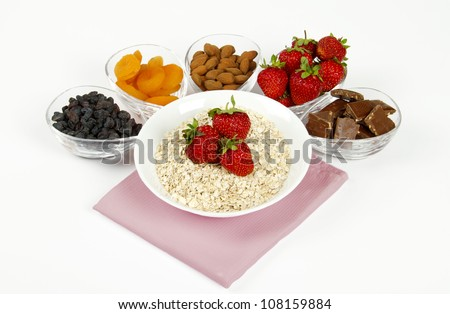 morning breakfast with oatmeal and strawberries - stock photo