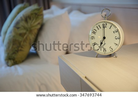 Morning clock in the bed room. - stock photo