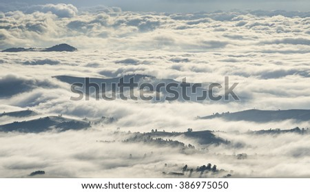 Morning clouds over mountains, forests and villages. Ukraine