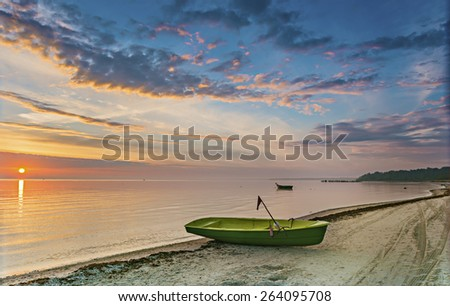 Morning coastal landscape with anchored fishing boat, Baltic Sea, Latvia, Europe - stock photo