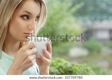 Morning coffee. Close up shot of a beautiful female holding a cup of coffee going to drink the beverage