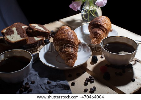 Morning coffee. Food. Croissant. Tasty breakfast. On the table of coffee and croissant. Coffee beans. Bakery products. Sweets.