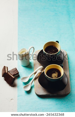 Morning Coffee Table. Two Cups of Espresso with Chocolate Cake and Milk Jug. Selective focus, top view. - stock photo