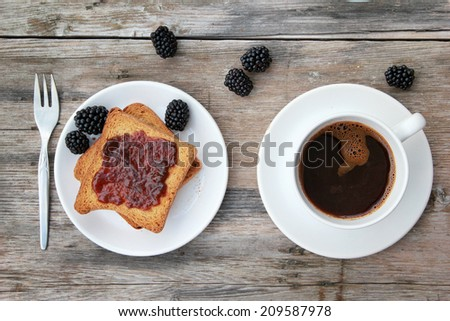 Morning coffee Toast with marmalade and coffee on wooden table - stock photo