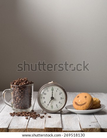 Morning coffee with alarm clock on table - stock photo
