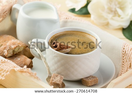 Morning coffee with cinnamon, milk and cookies (close-up) - stock photo