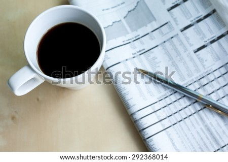 Morning coffee with newspaper - stock photo