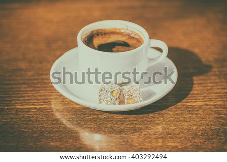 morning creativity concept of cup coffee with delight, instagram style or toned effect, close up - stock photo