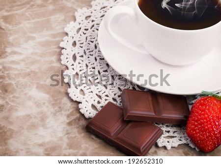 Morning Cup of coffee, chocolate and strawberry on the marble background.