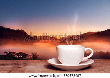 cup of coffee ot tea on rustic nature background at sunrise ...