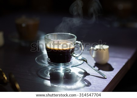 Morning cup of hot coffee on the table - stock photo