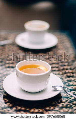 Morning cup of tea with lemon slice inside - stock photo