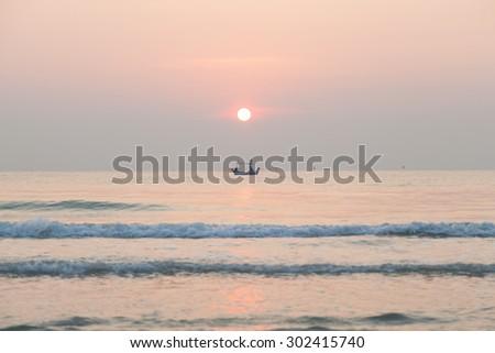 Morning fishing boat Sunrise in the morning The fishing boat out fishing in the morning. - stock photo