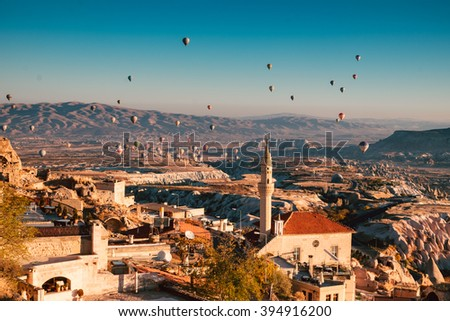 Morning flight above Uchisar town and Goreme valley  in Cappadocia. - stock photo
