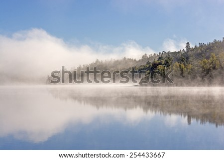 Morning Fog and Clouds on Ottertrack Lake in Quetico Provincial park