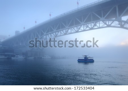 Morning Fog, False Creek, Vancouver. Early morning fog rolls under the Granville Bridge over False Creek in downtown Vancouver. British Columbia, Canada.  - stock photo