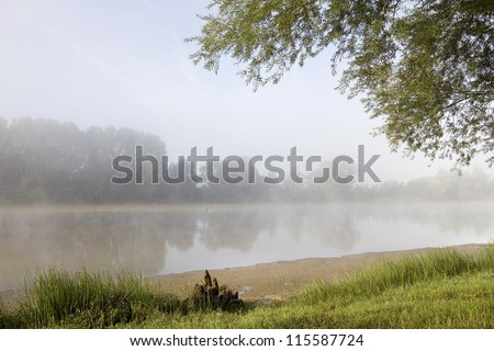 morning fog in loire river, france - stock photo
