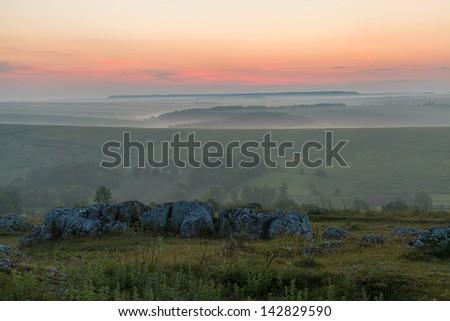 "Morning fog in the hills of the National Park ""PodÃ?Â??lskÃ?Â?? Tovtry"" - stock photo"