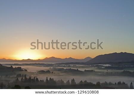 morning fog in Upper Bavaria in Pfaffenwinkel - stock photo