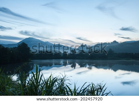 Morning fog on a swamp and mountains. - stock photo