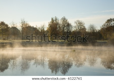 Morning fog over calm water