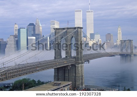 Morning fog over the Brooklyn Bridge looking into Manhattan, NY - stock photo