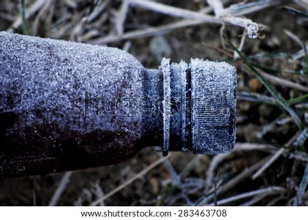 Morning frost on a plastic bottle - stock photo