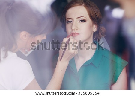 morning in the beauty salon where they make excellent makeup bride - stock photo