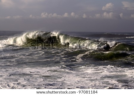 Morning in the north Portuguese coast seeing clouds an waves - stock photo