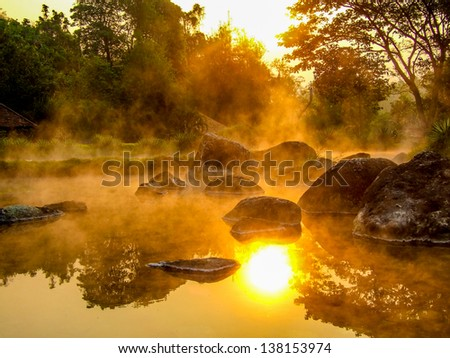 Morning is beautiful gold steam hot spring with sunlight at Jae Son National Park,Thailand - stock photo