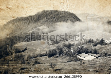 Morning landscape in the Apennines mountains in Italy. Old photo effect applied.