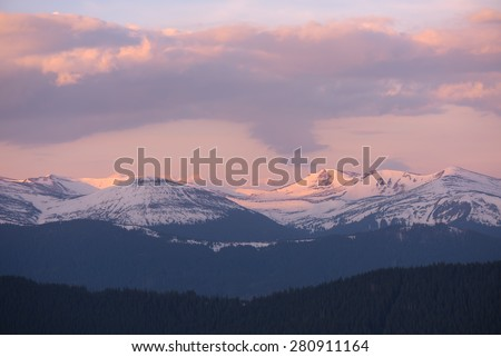 Morning landscape. Spring in the mountains. Snow on the tops - stock photo