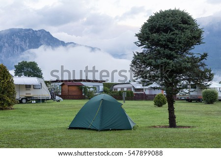 Morning landscape with a camping in mountains