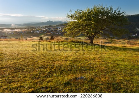 Morning landscape with a view on the small mountain tourist resort Zabljak in Montenegro - stock photo