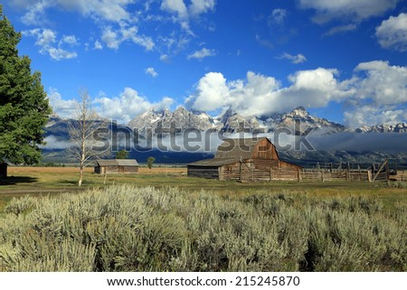 Morning landscape with a vintage barn in the Tetons, Wyoming, USA. - stock photo