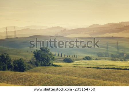 Morning landscape with the high voltage line, Tuscany, Italy