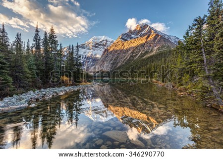 morning light and reflection of Mount Edith Cavell in Jasper National Park, Alberta, Canada - stock photo