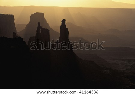 Morning light filters in on the Washer Lady as seen from Mesa Arch at Sunrise Canyonlands National Park Utah
