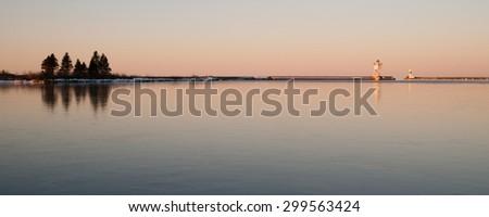 Morning Light Harbor Grand Marais Lighthouse Lake Superior Minnesota USA - stock photo