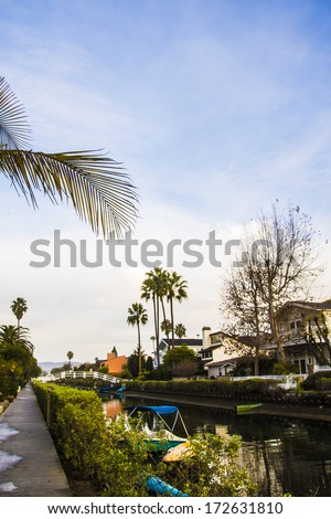 Morning light on a canal/Venice Canal/Canal with boats homes and light reflecting on water - stock photo