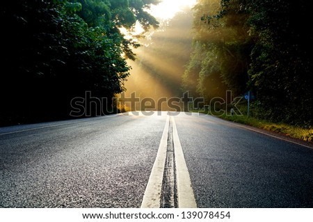 Morning light on the road. - stock photo