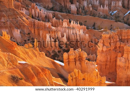 Morning light warms the Hoodoo Formations from the rim of Bryce Canyon Bryce Canyon National Park Utah