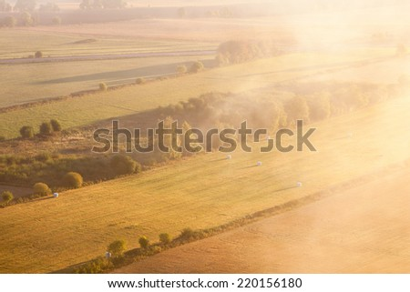 Morning mist in countryside landscape - stock photo