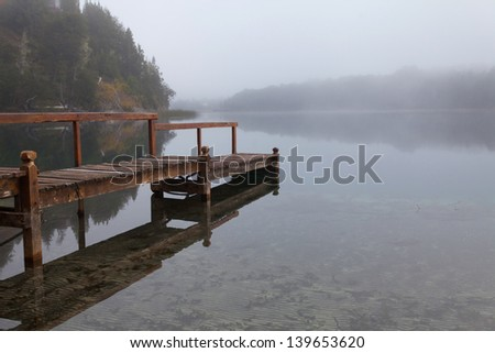 Morning mist on the mountain lake - stock photo