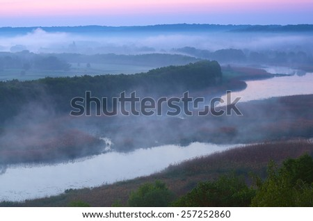 Morning mist over the river. View from the hill. River Ros, Ukraine, Europe - stock photo