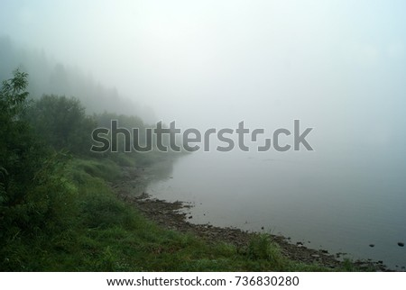 morning mist over the Ural river Vishera, view from the shore. the shore in the background is lost in the haze