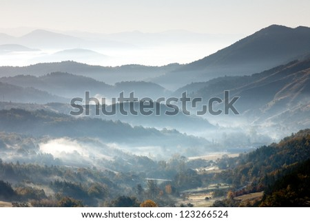 Morning mountain landscape with fog - stock photo