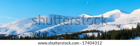 Morning mountain panorama with long blue daybreak shadows and moon in sky (Drahobrat Ski Resort, Yasenja village, Zacarpatsjka Region, Carpathian Mt's, Ukraine). Ten shots stitch image.